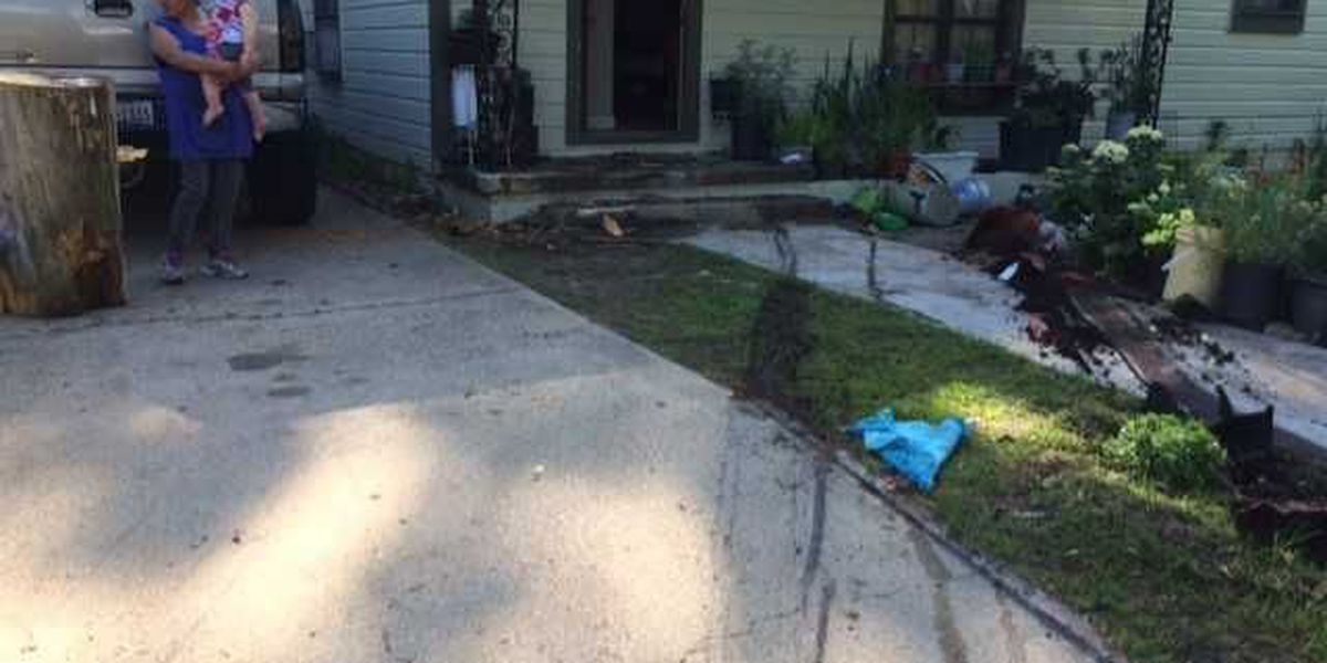 Car jumps curb, crashes into porch of Longview home, narrowly misses resident