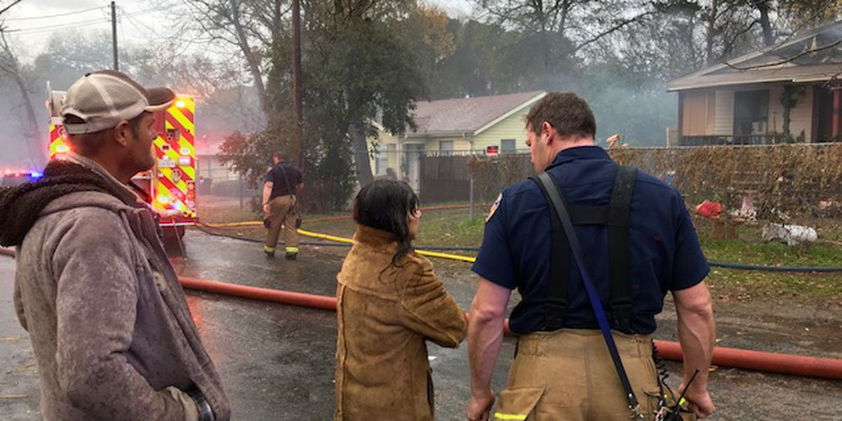 Firefighters extinguish flames inside Longview home damaged by fire