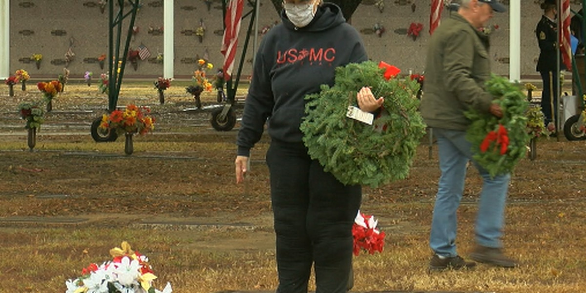 Wreaths placed on gravestones at Tyler's Memorial Cemetery to honor veterans in nationwide ceremony