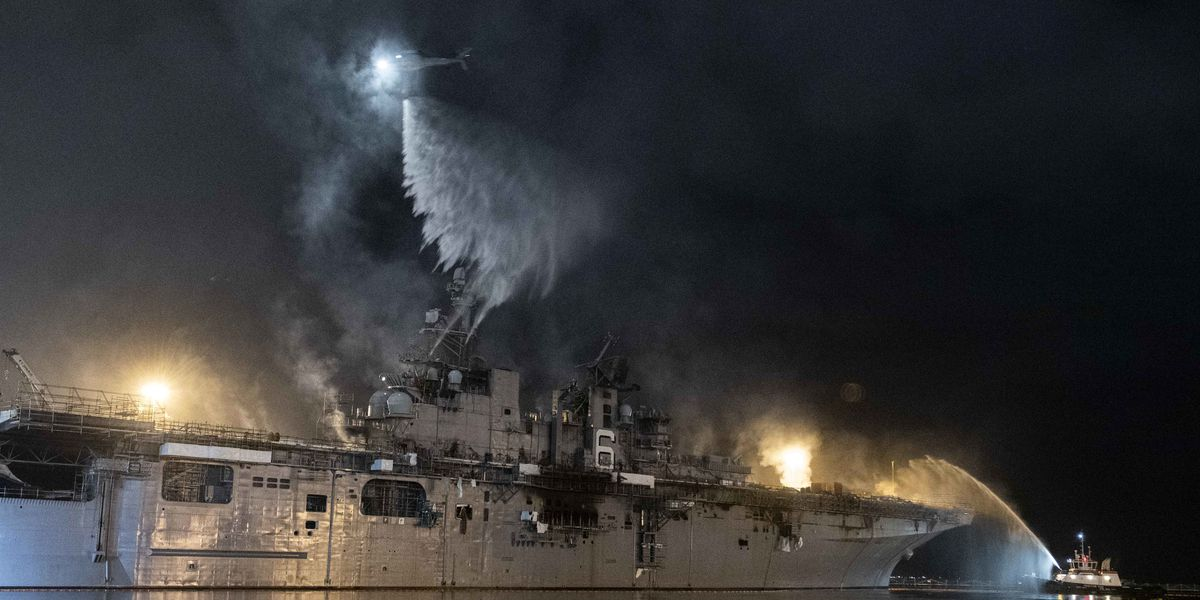 Explosion threat eases at burning Navy warship in San Diego