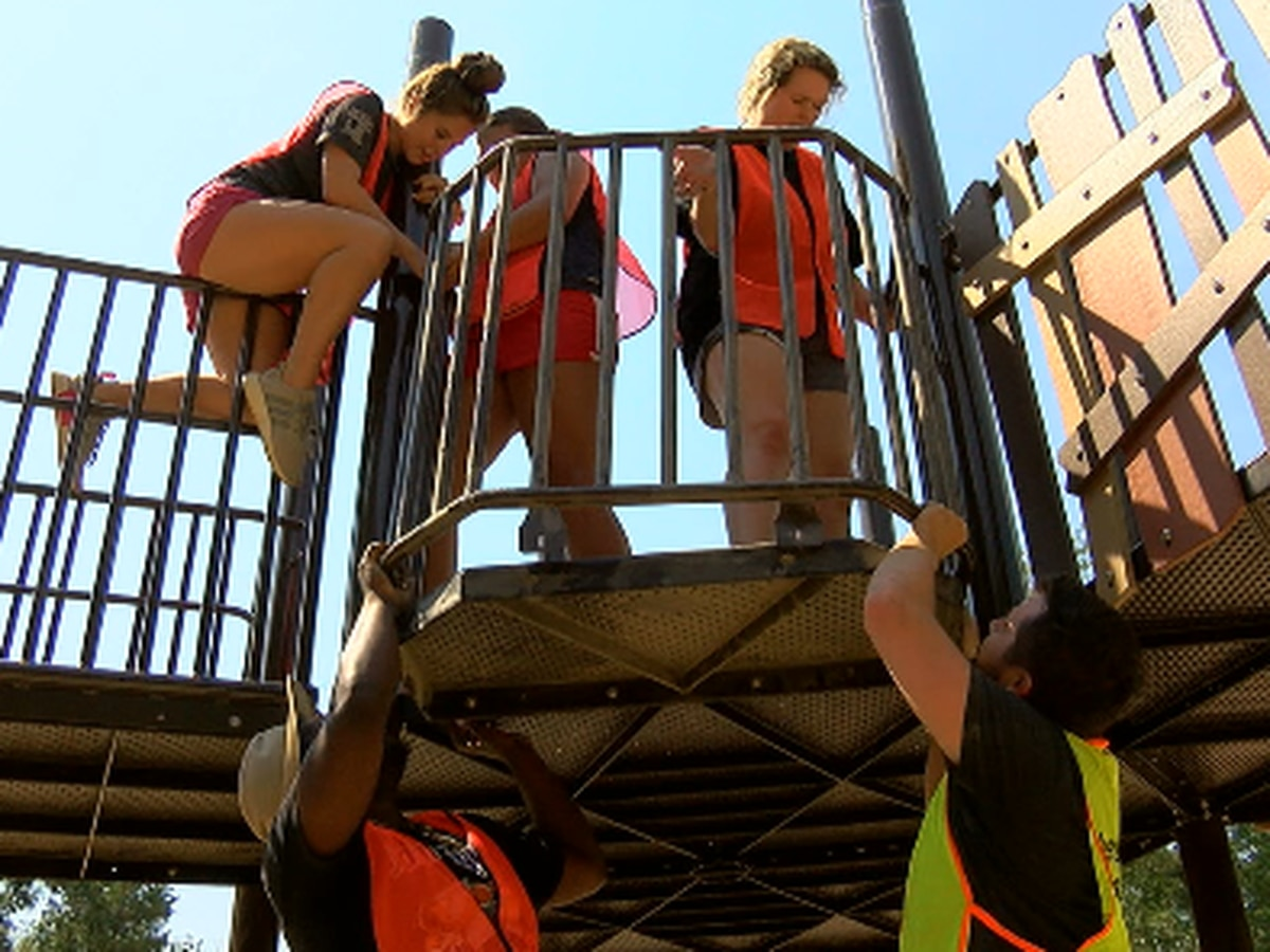 Volunteers help build new inclusive playground