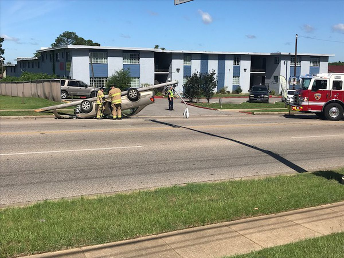 VIDEO: Car flips upside down after striking power pole in Longview