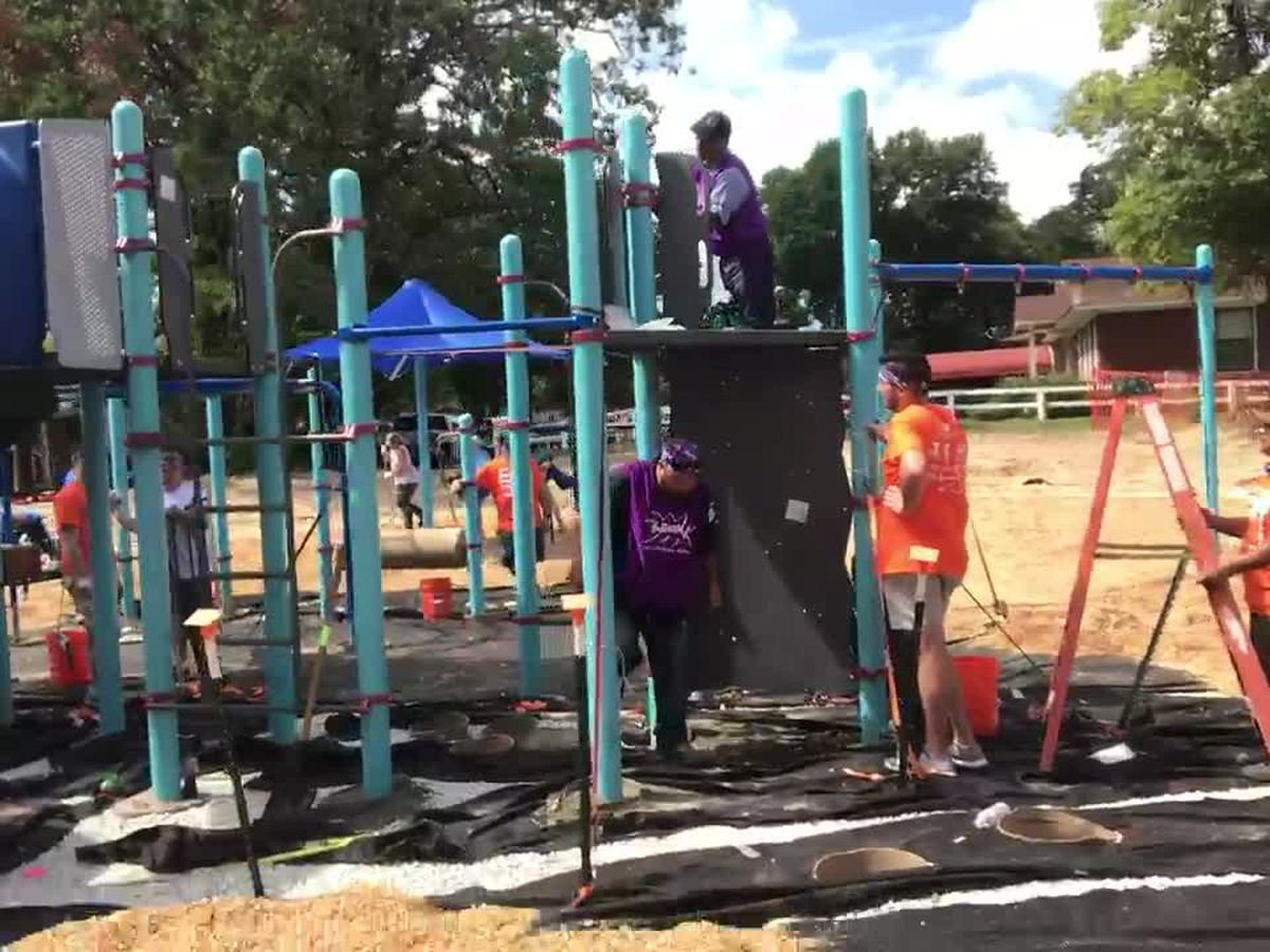 WEBXTRA: Volunteers build the new and improved Gassaway Park