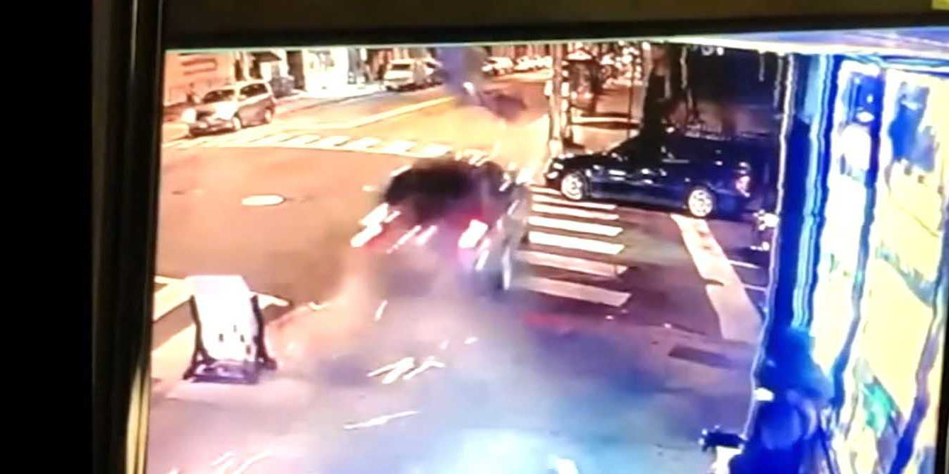 Video: Alleged drunken driver speeds down sidewalk, narrowly misses man and knocks down light pole