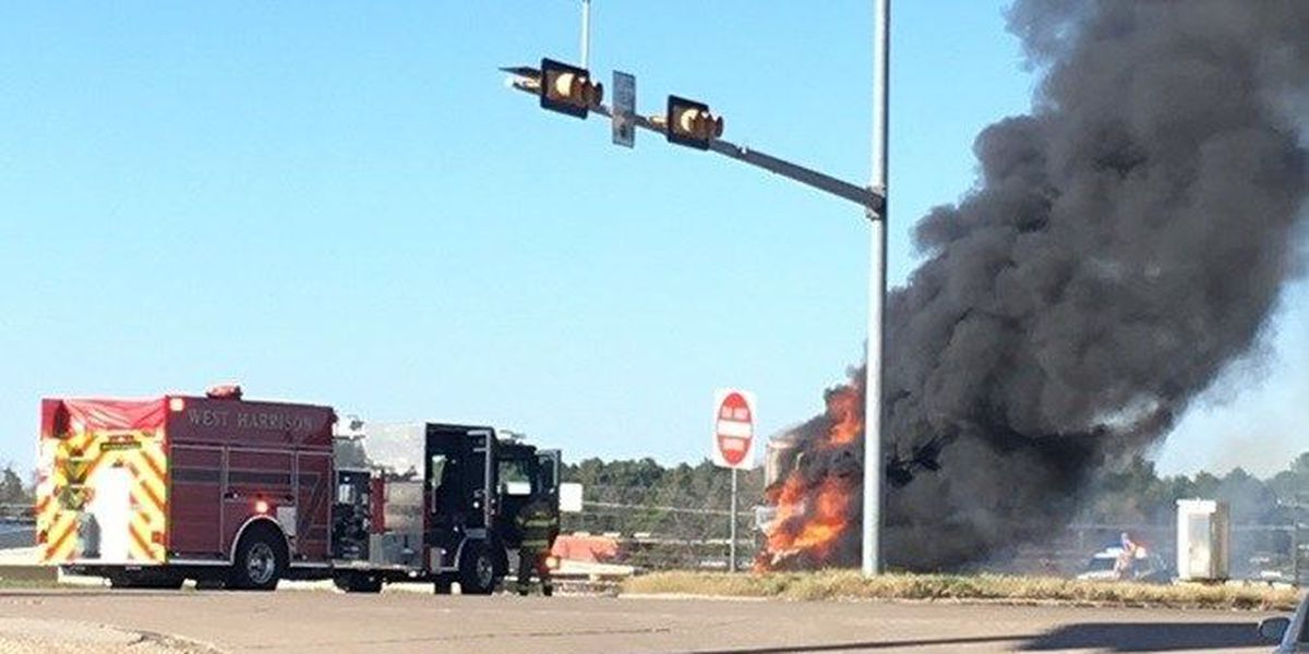 Moving truck goes up in flames on I-20 overpass in Harrison County