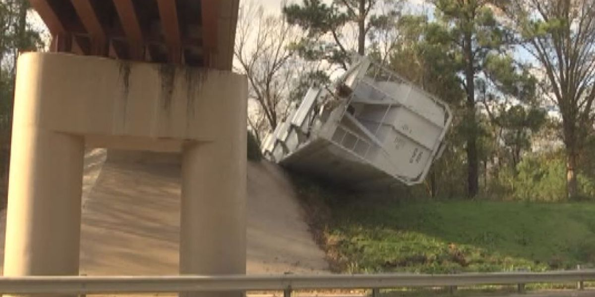 Rail regulations investigated after wind topples train cars from bridge