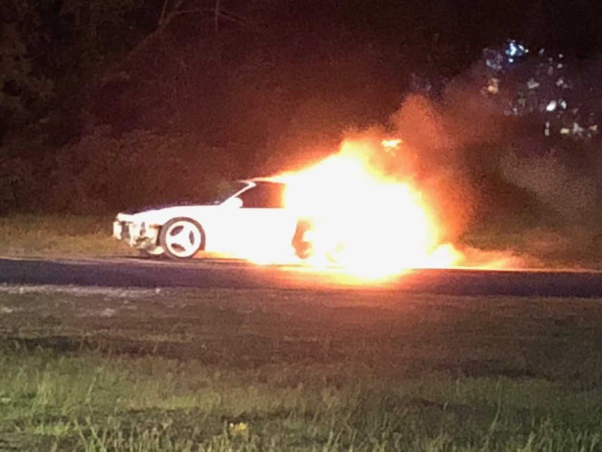 Fire crews on scene of vehicle fire in parking lot of Tyler business