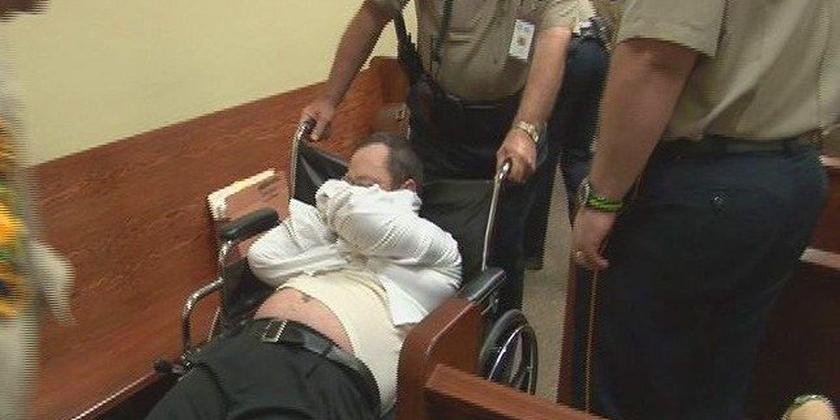 Capital murder defendant dragged into court after refusing to appear