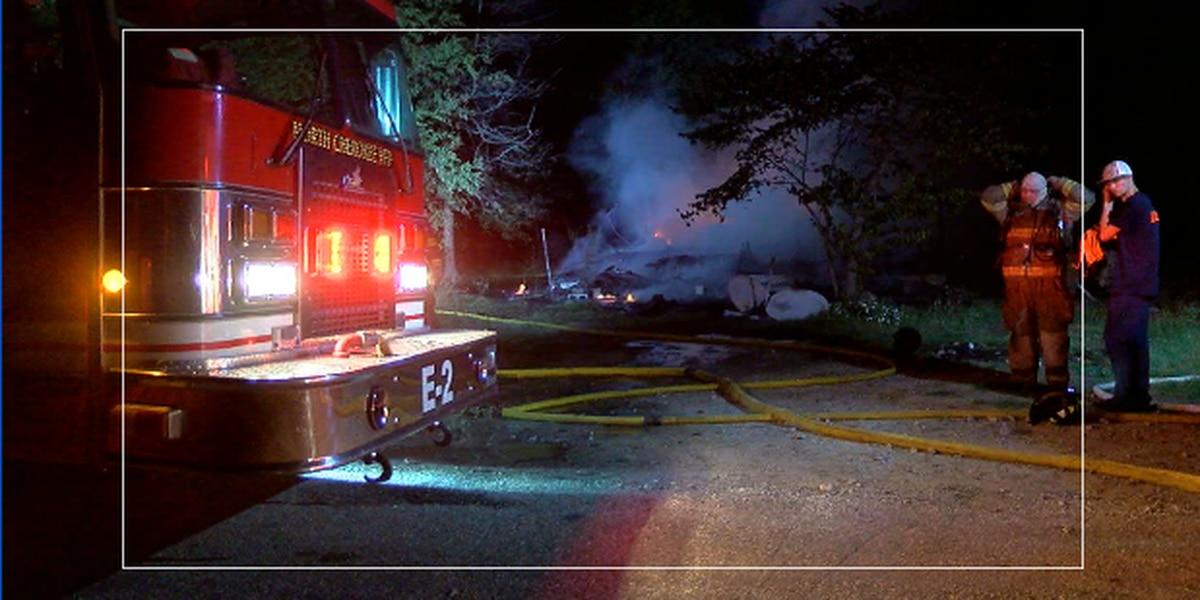Firefighters battle house fire in Cherokee County