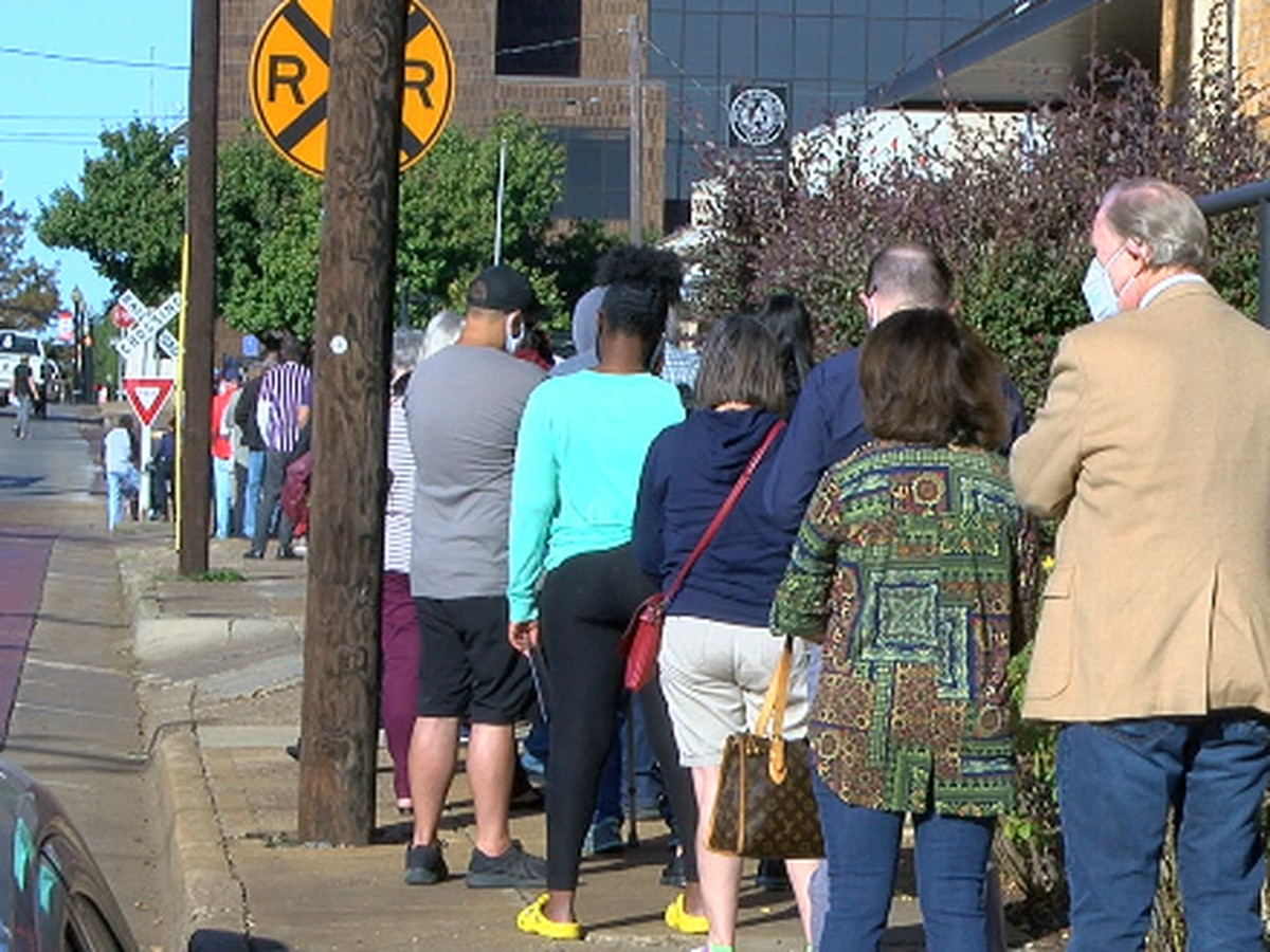 Long lines, COVID-19 safety protocols seen on first day of early voting