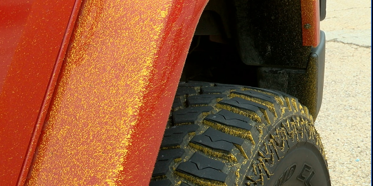 Wet road paint on Highway 155 splattered white, yellow paint on vehicles