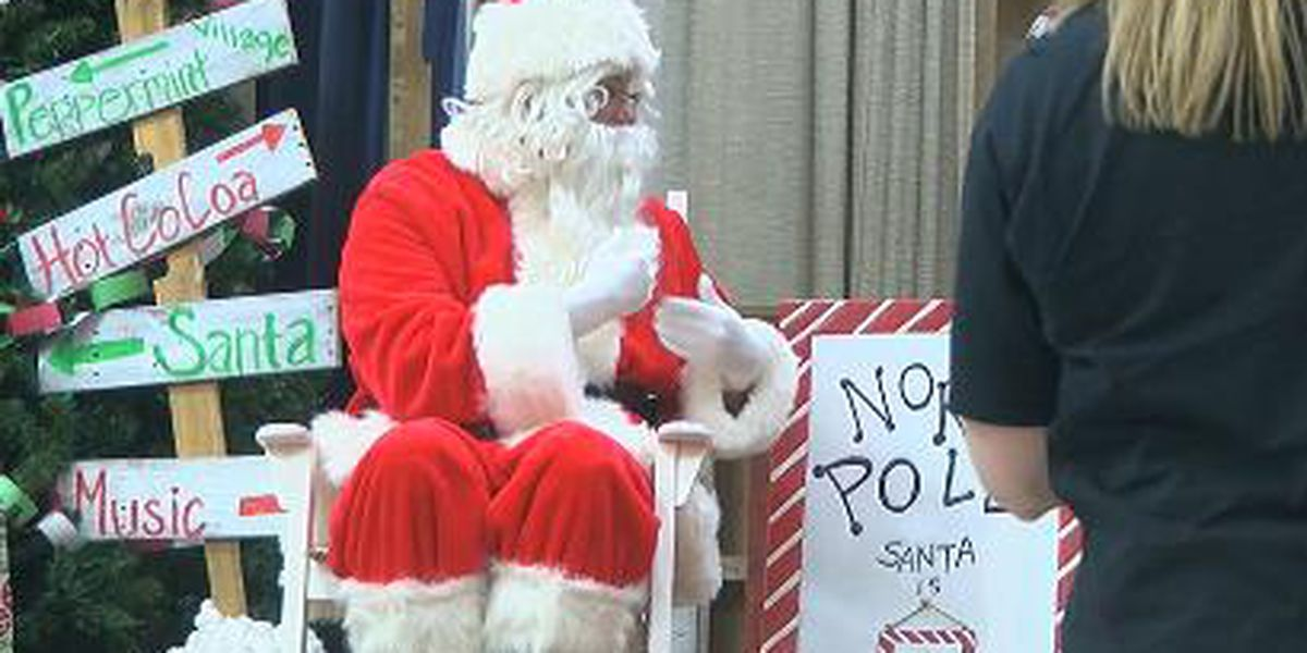 The Signing Santa takes kid's wish lists at Longview elementary school