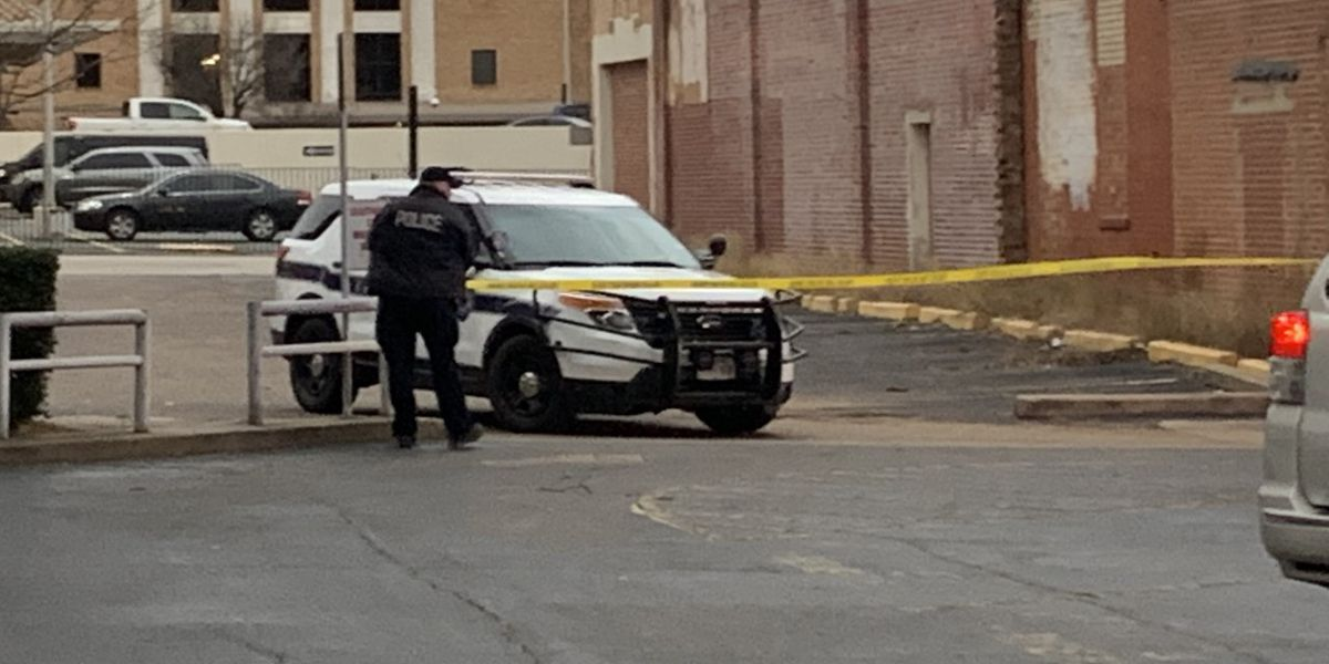 Police investigating body found in parking lot