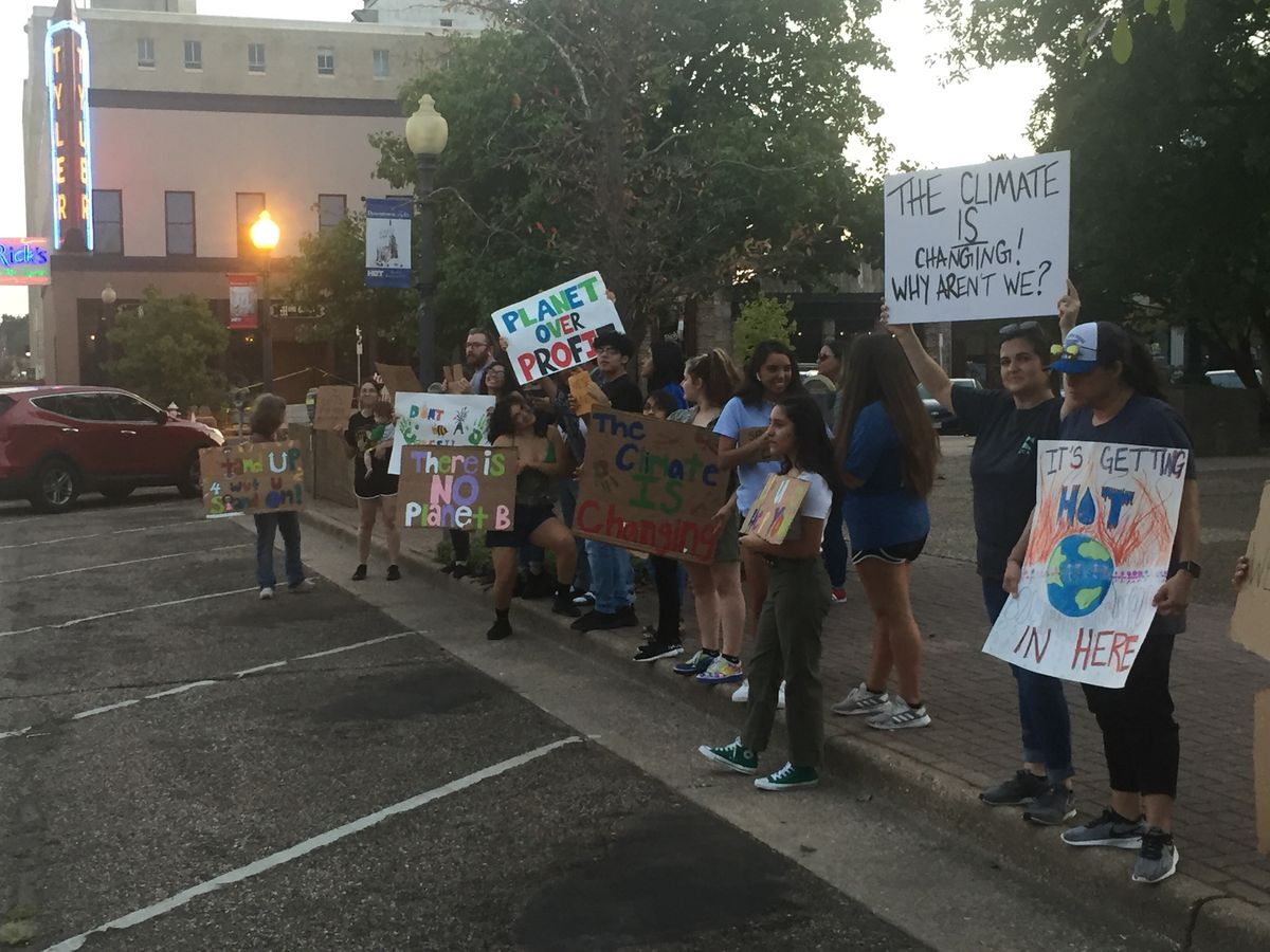 Group demonstrates in downtown Tyler to draw attention to climate change