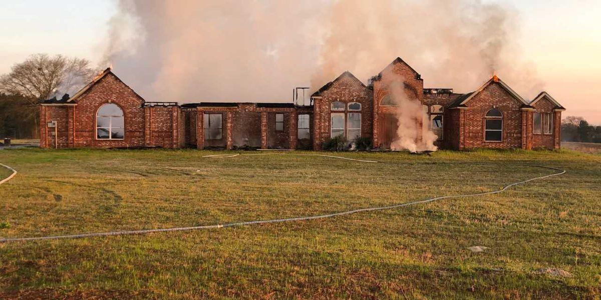 Crews battling house fire west of Tyler