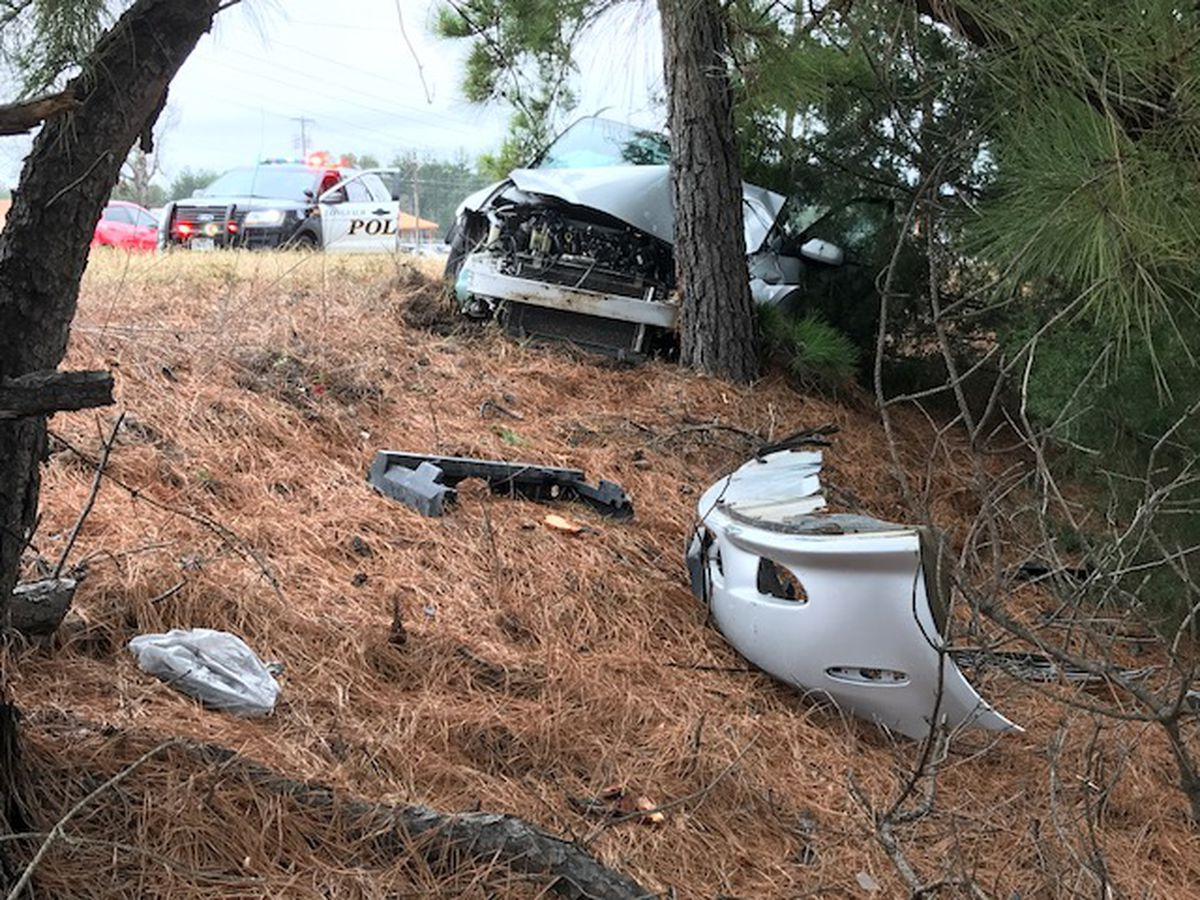 Driver crashes into tree after blowout in Longview