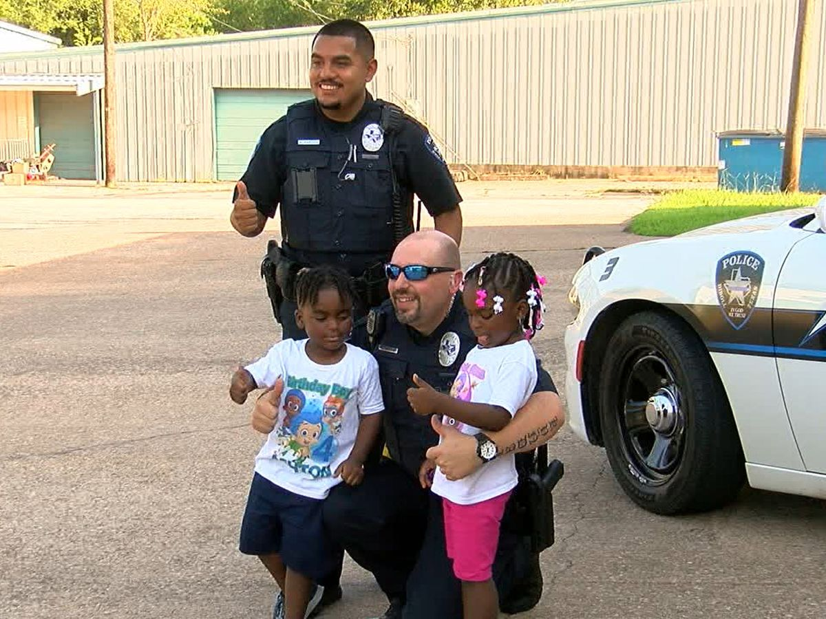 Diboll police officers crash twins' birthday party with gifts, fun
