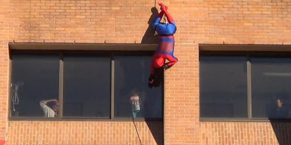 Superheroes swarm Longview hospital