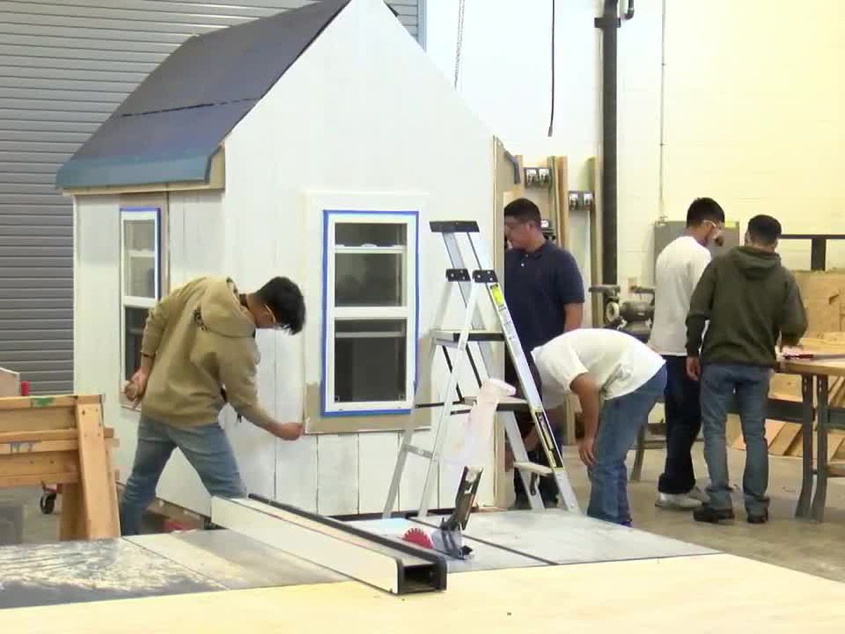 TISD Construction and Technology students building playhouse for Habitat for Humanity
