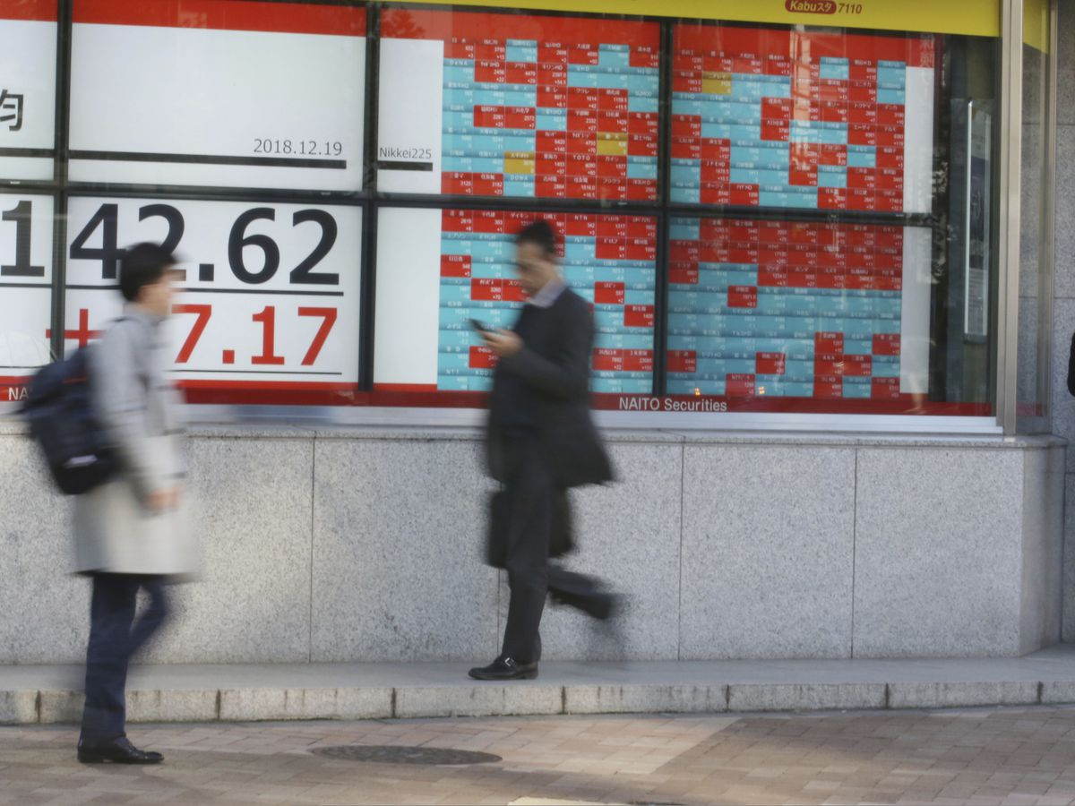 Stocks mixed in Asia on Fed rate decision, Japanese data