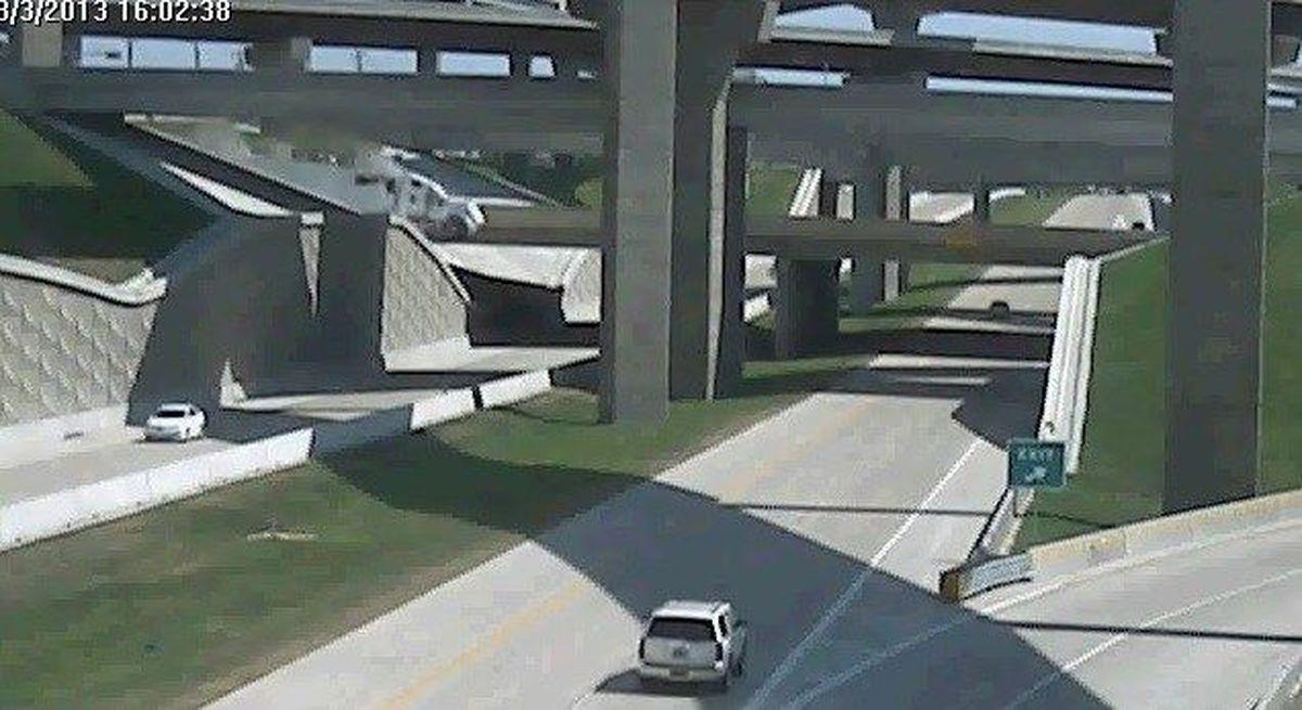 VIDEO: 18-wheeler crashes through I-30 guardrail, falls to highway below