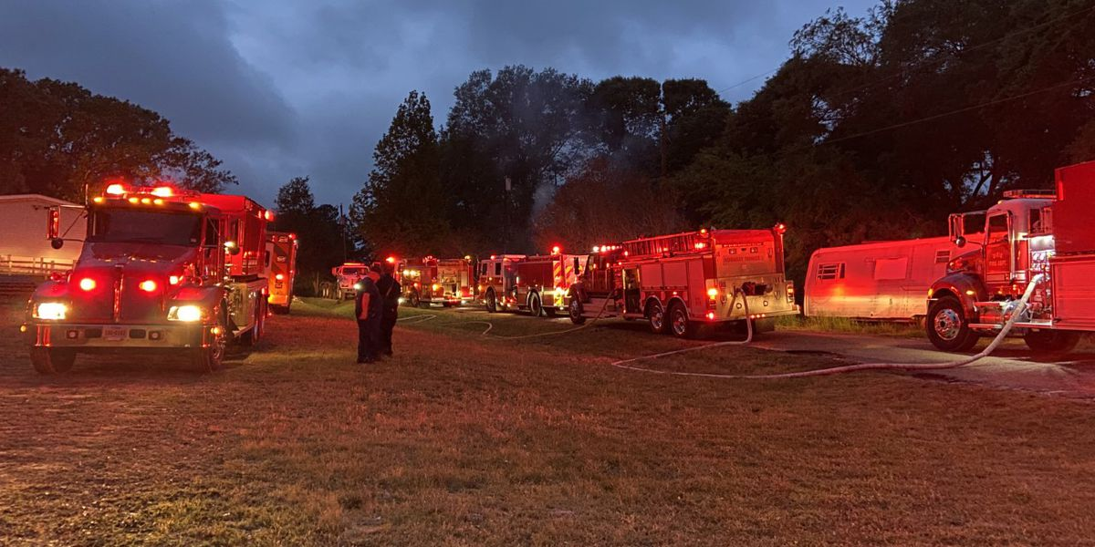 Several departments battling out-of-control trash fire in Smith County