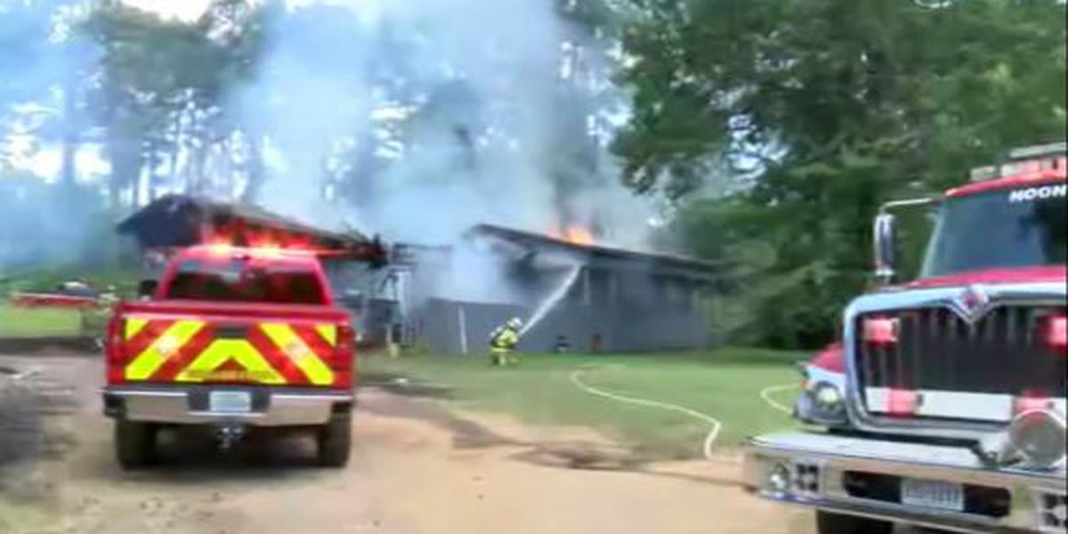 Firefighters battling 2 building fires in Henderson County