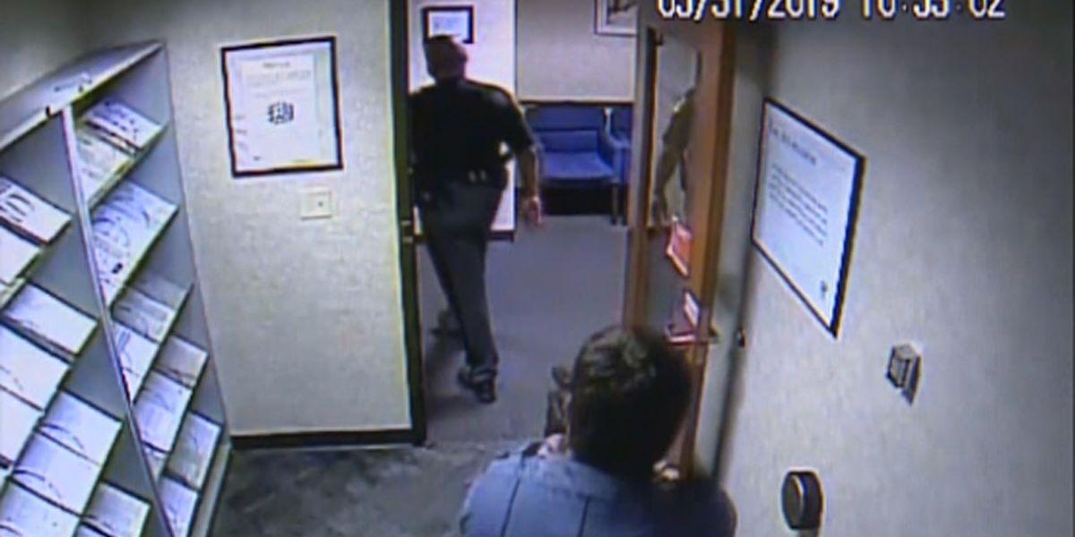 Caught on video: Security guard pulls gun on deputy in uniform