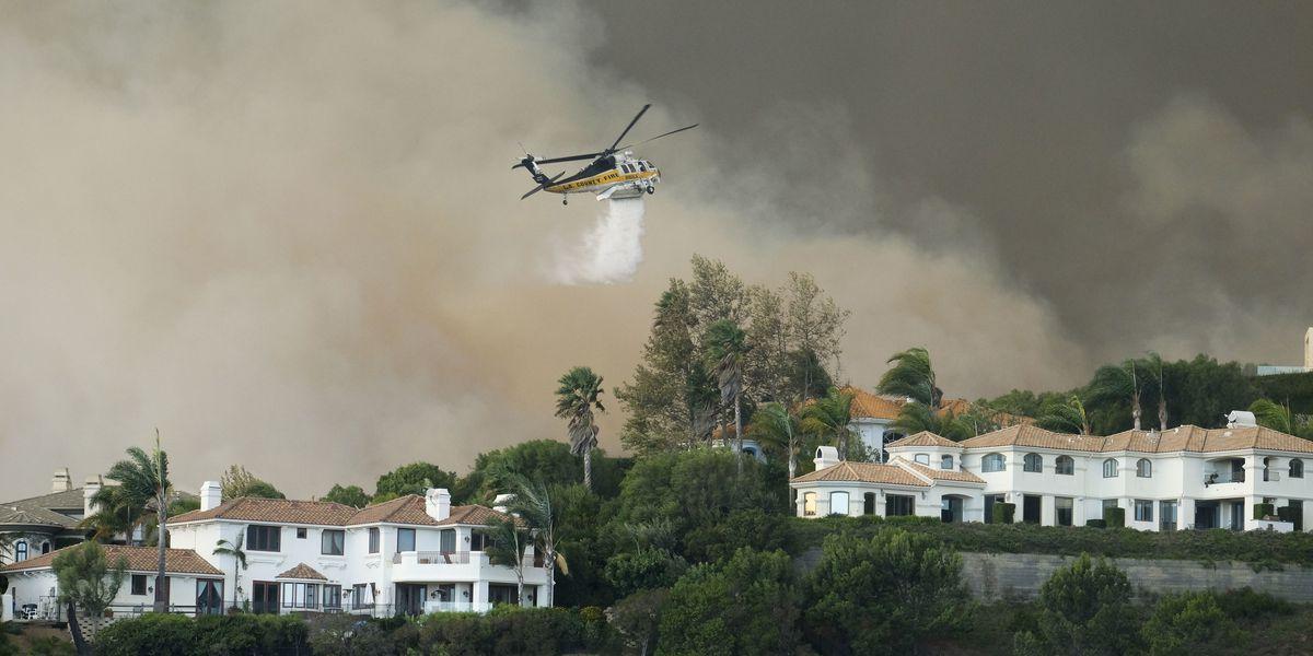 Fires besiege California city reeling from mass shooting