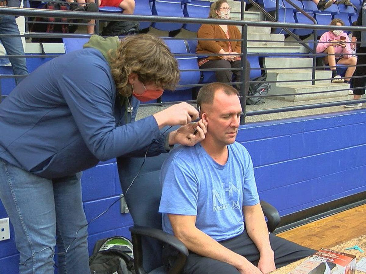 Central Heights coach honors bet with players, gets haircut