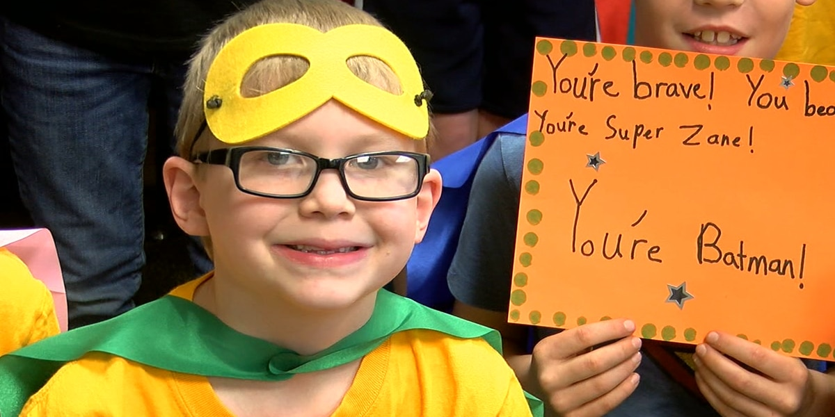 8-year-old beats cancer, classmates give him a hero's welcome