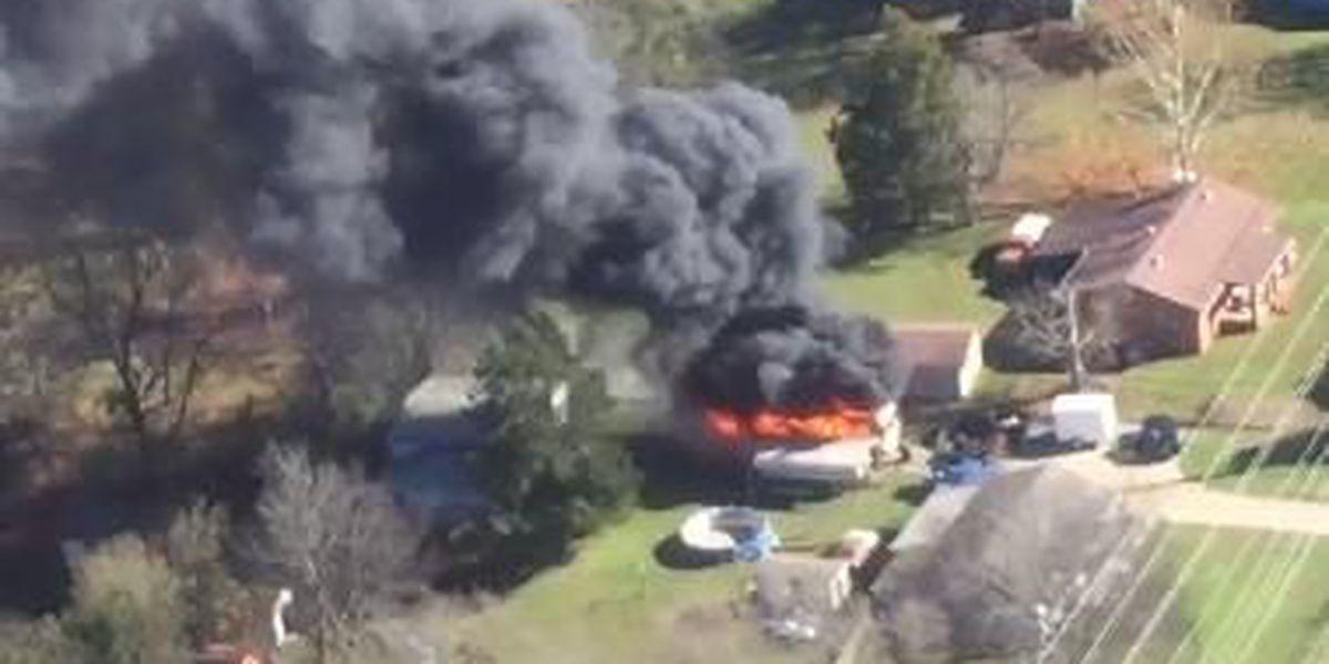 RV destroyed by fire, owner glad pets, house weren't endangered