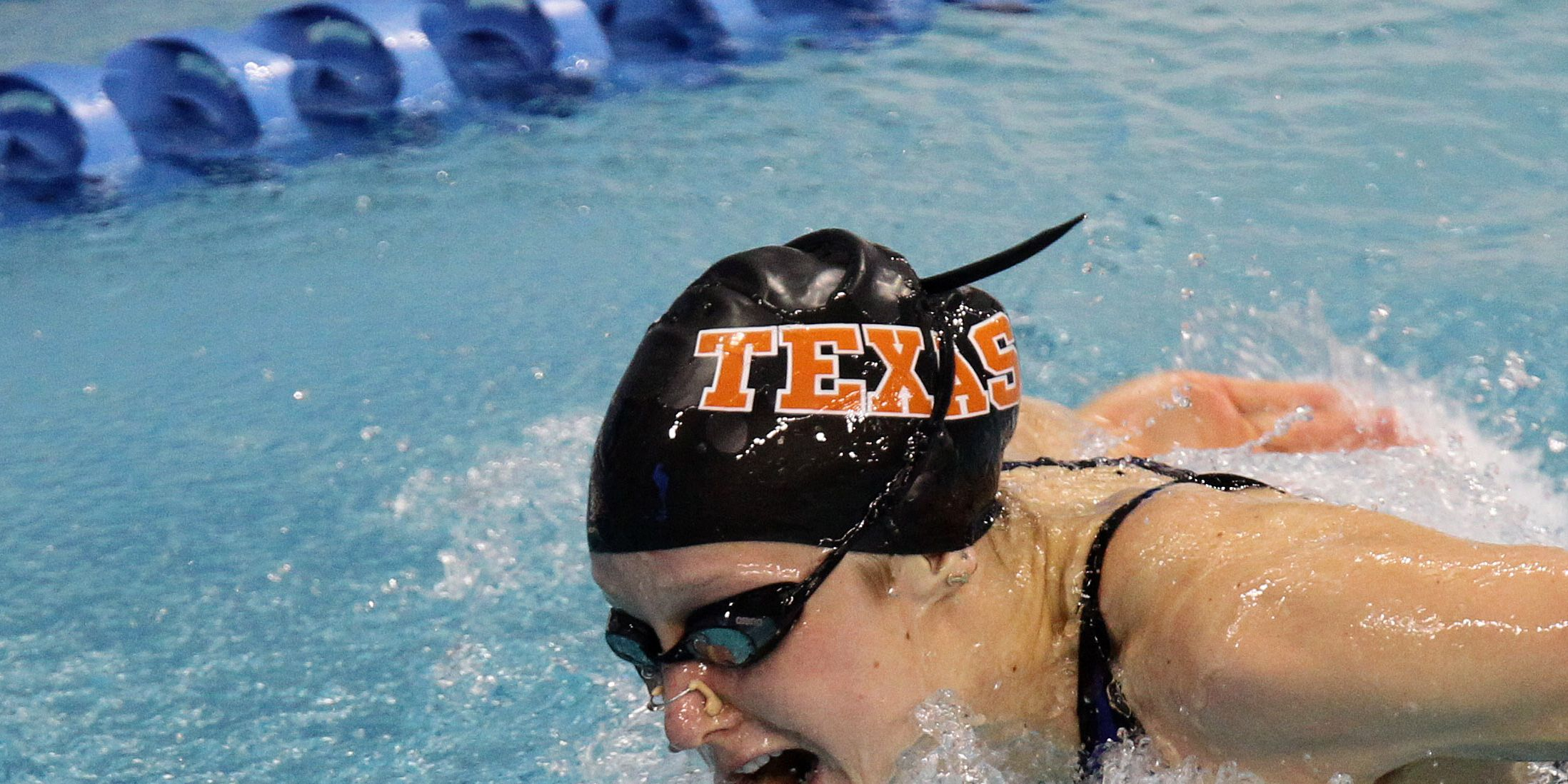 Ex-Texas swimmer sues company over alleged tainted vitamins