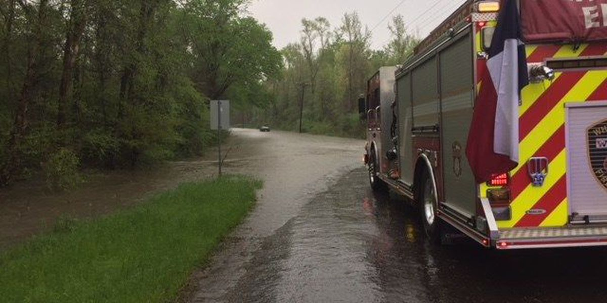 Two escape car trapped in high waters in Smith County