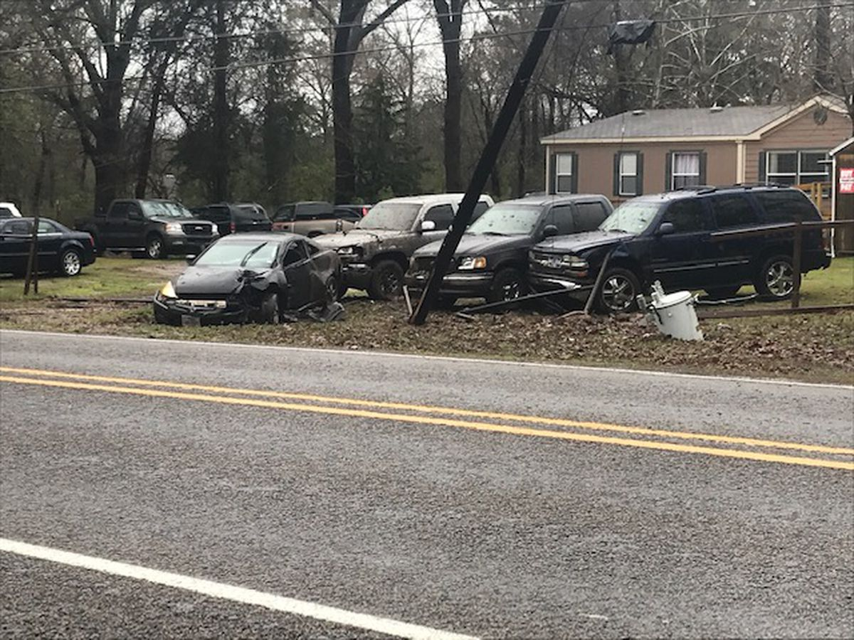 Car strikes power pole, 3 vehicles in lot in Gregg County