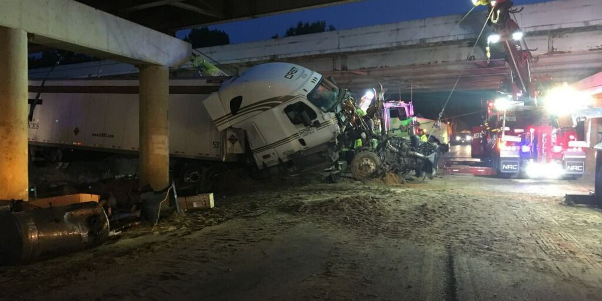 2 people injured after 18-wheeler drives off I-20, shuts down traffic on Woodsprings Road