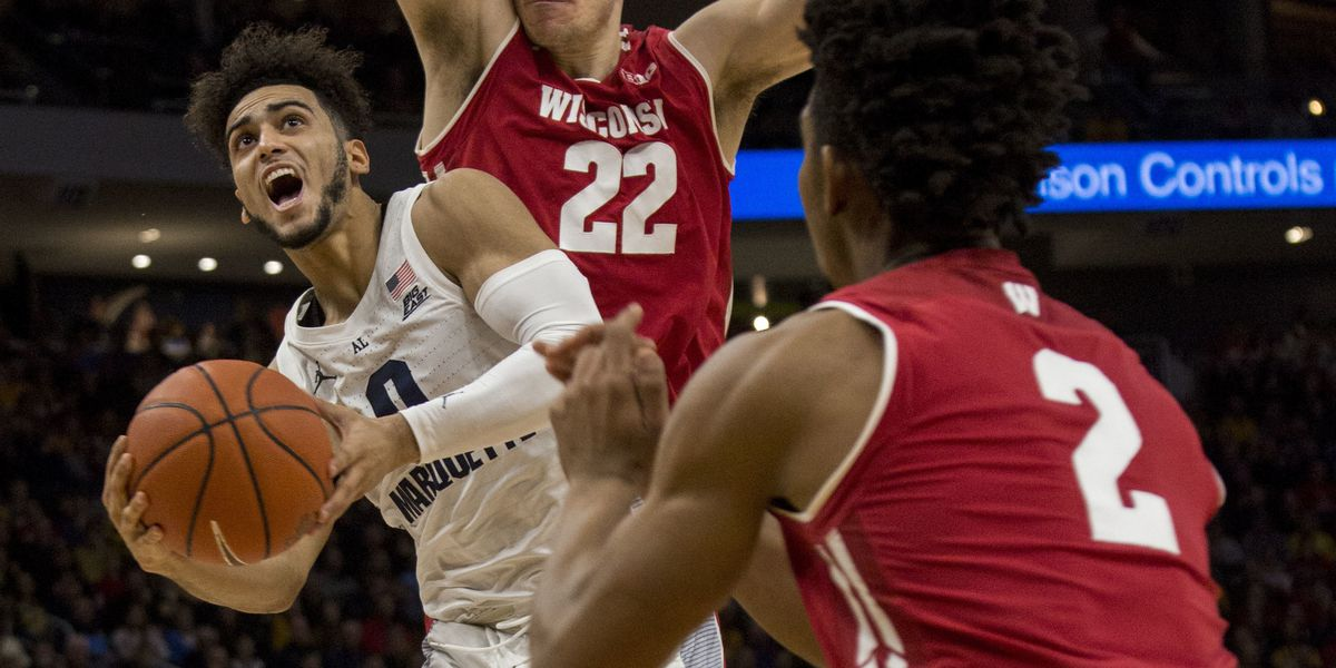 Marquette beats No. 12 Wisconsin 74-69 in OT; Howard has 27