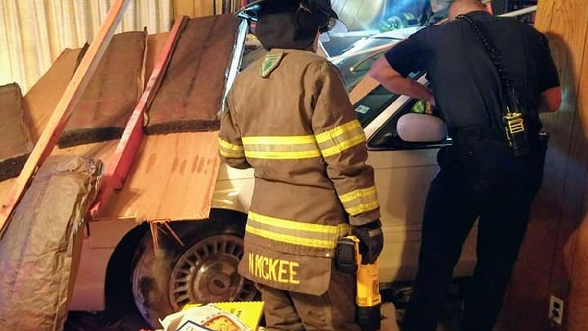 WEBXTRA: Gregg County fire crews rebuild wall after car crashes into home