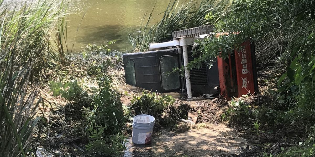 Trailer carrying Bobcat machinery leaves road, crashes into lake near Gladewater