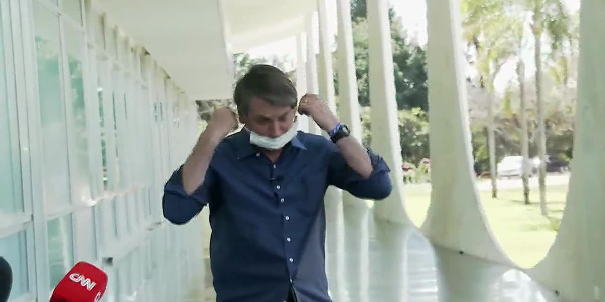 Brazil's President Bolsonaro tests positive for virus, takes mask off in front of reporters