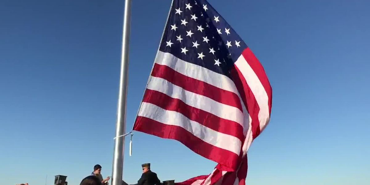 WEBXTRA: Flags raised on Vera Bank's new flagpoles