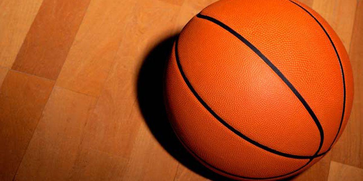 Basketball Player plants face on backboard