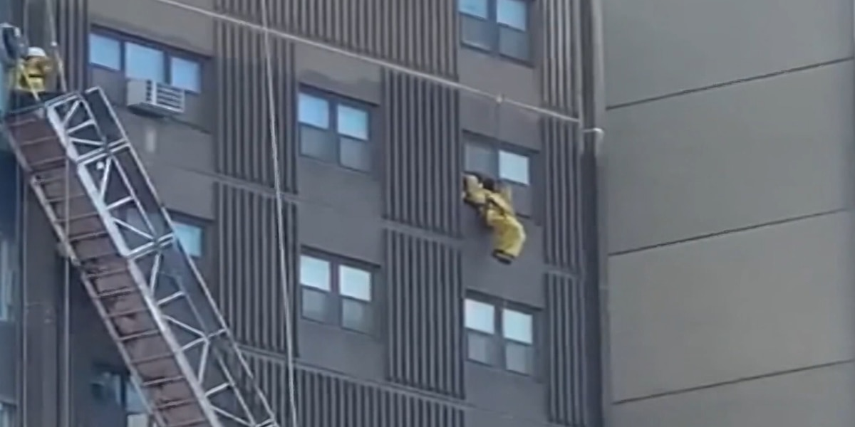 A dramatic rescue was caught on camera after scaffolding collapsed 13 stories up