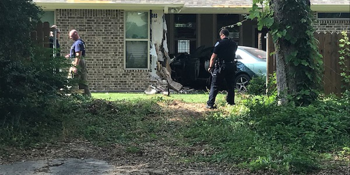 Vehicle crashes into house, injures at least one